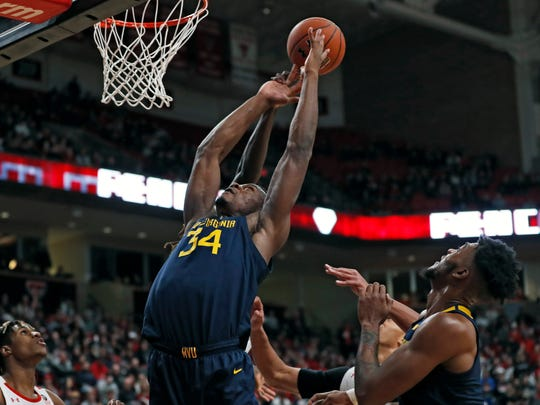 West Virginia's Oscar Tshiebwe (34) tries to rebound the ball during the first half of an NCAA college basketball game against Texas Tech, Wednesday, Jan. 29, 2020, in Lubbock, Texas. (AP Photo/Brad Tollefson)
