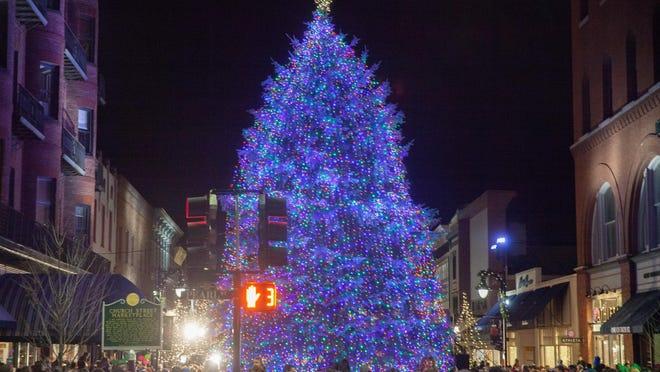 A crowd on Church Street spills onto Pearl Street following the Church Street Christmas tree-lighting ceremony Friday night.