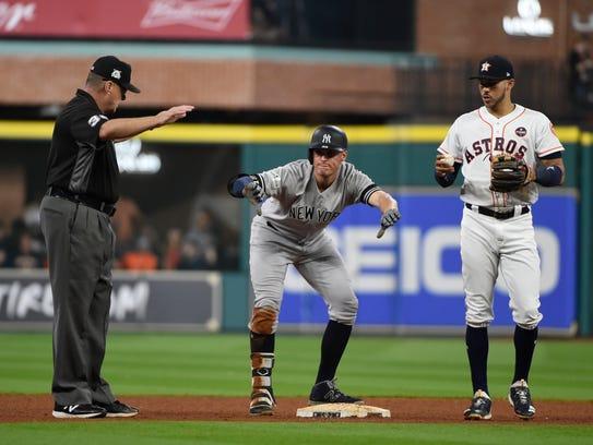 New York Yankees' Greg Bird reacts after hitting a