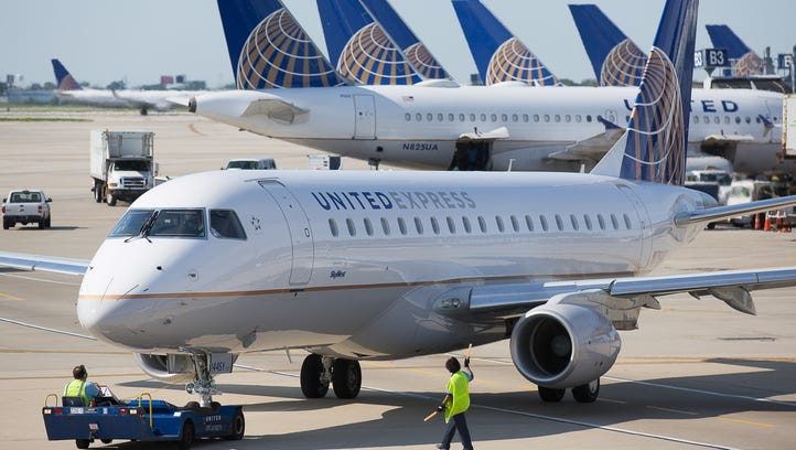 A United Express Embraer E170 jet prepares for departure