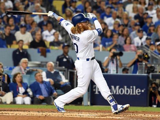 Dodgers third baseman Justin Turner blasts a three-run