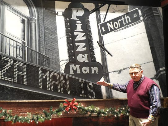 Founder of Pizza Man Mike Amidzich stands in front