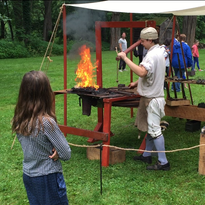 Jim Burr Jr. of Poughkeepsie shows how metalworking was done in the 1700s for visitors to the Historic Huguenot Street July 4 event.