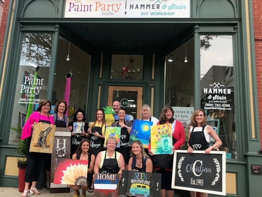 Customers from The Paint Party Studio and Hammer and