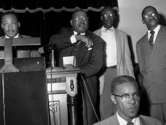 The Rev. Martin Luther King Jr., standing from left, Rev. H.H. Johnson, E.D. Nixon and Rev. A.W. Wilson during a mass meeting at Holt Street Baptist Church in Montgomery, Ala., during the Montgomery Bus Boycott.  (Advertiser file)