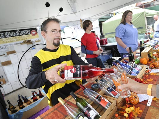 Mike Pforr, assistant wine maker at Bee Kind Winery, sports a bee costume as he pour a sample of their wine during Yorktoberfest at Sovereign Bank Stadium on Saturday, Oct. 27, 2012.  (YORK DAILY RECORD/SUNDAY NEWS--JASON PLOTKIN)