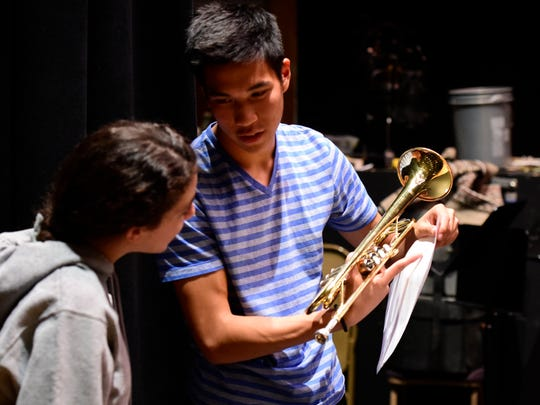 Warren Chan, of Vestal, goes over a music sheet with Yuval Tessman-Bar-On, of Binghamton, during band practice at the school's auditorium on Tuesday.