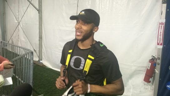 Oregon's Kyree King talks to the media after setting