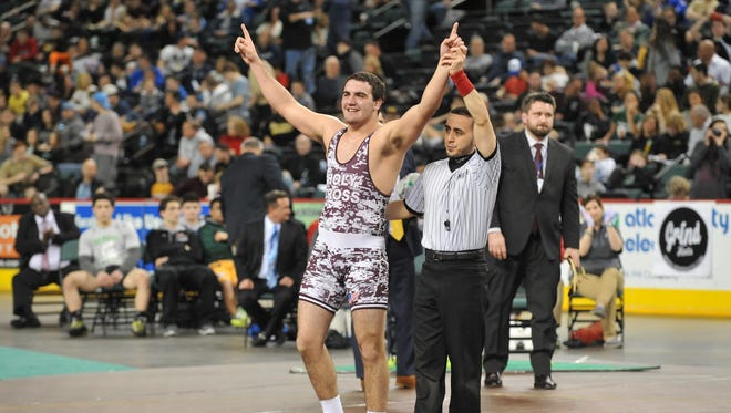 Holy Cross's Matt Correnti celebrates his win over Philipsburg's Robert Melise at 220 pounds, in the NJSIAA State Championships, Sunday, Mar. 6, 2016 at Boardwalk Hall in Atlantic City.