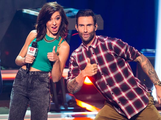 The Voice Season 6 contestant Christina Grimmie with her coach on the Voice and Maroon 5 vocalist Adam Levine, August 26, 2014.