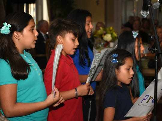 The Grace Place Children's Chorus entertains the guests on April 1 during the Red Wagon Gala.