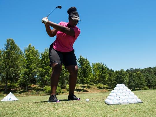Kelpie Jackson, 15, of Miami, Fla., practices at the