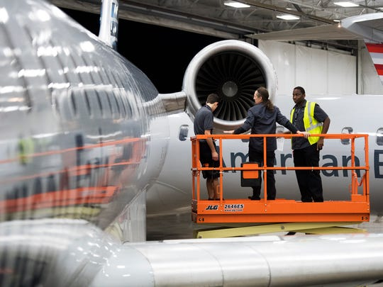 Demetris Johnson, David Butts and Cory Lyons inspect an airplane engine at the GreenvilleÐSpartanburg International Airport on Tuesday, Oct. 3, 2017.