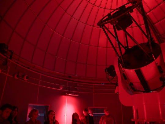 A tour gets a look a the telescope at the Rancho Mirage