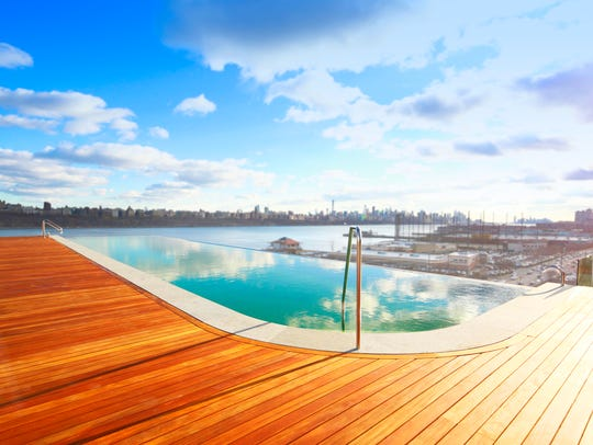 The infinity pool with views of Manhattan is a highlight