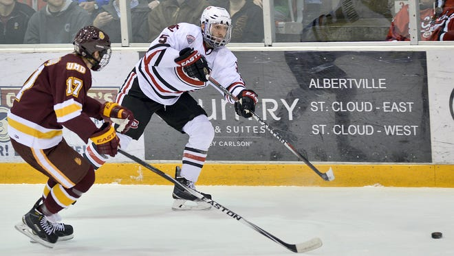 Nate Widman (5) has gone from walk-on last season to being an alternate captain and a team leader on defense for St. Cloud State this season.