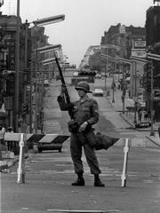 A National Guardsman stands watch in the Central Ward on July 15, 1967.