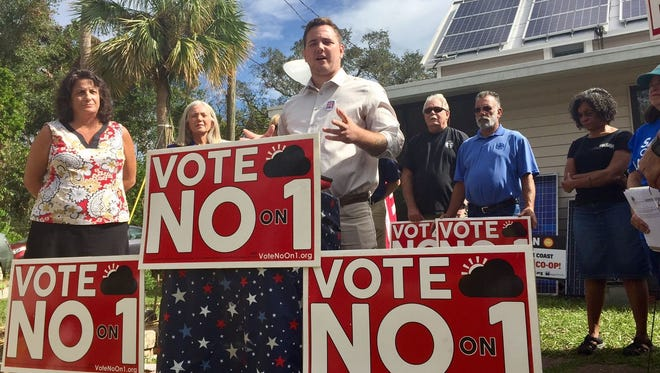 Dustin Waite of Solar Energy Systems of Brevard criticizes Amendment 1 during a press conference Thursday in Titusville.