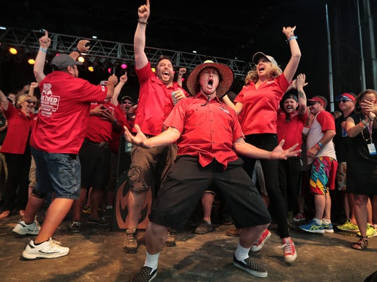 Brad Orrison celebrates with his team after The Shed took home a purse of about $34,000, coming out on top of Big Bob Gibson's Bar-B-Q and 10 Bones BBQ to win the grand championship at the Memphis in May World Championship Barbecue Cooking Contest at Tom Lee Park.