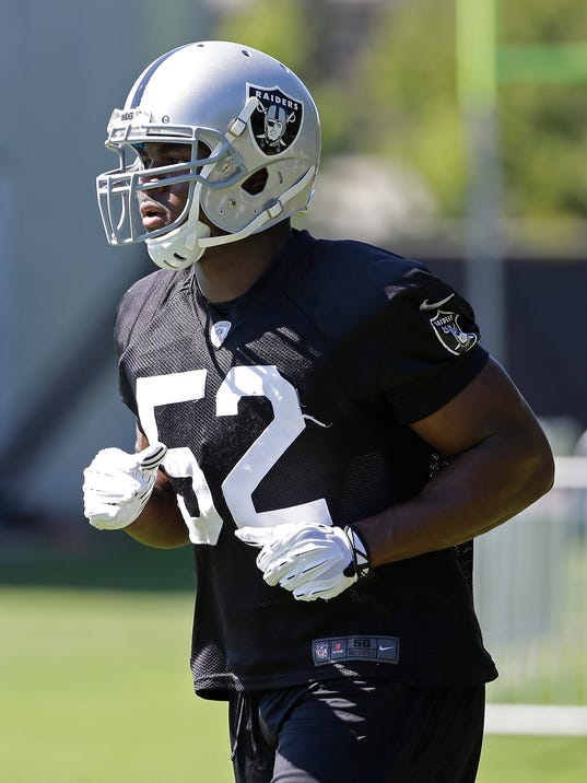 Oakland Raiders outside linebacker Khalil Mack runs to his next drill during an NFL football training camp on Friday, July 25, 2014, in Napa, Calif. (AP Photo)