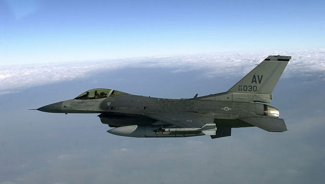 An American F-16 flies towards Rimini, Italy, to join with the Italian Air Force in a 2001 training mission.