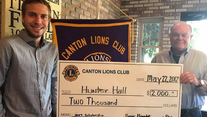 Hunter Hall (left) accepts a $2,000 scholarship from Canton Lion Bob Harris.