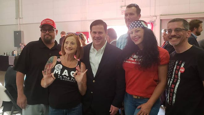 The photo posted on Facebook on April 28, 2018, has caused backlash toward Gov. Doug Ducey. While appearing at the Mohave County Republican Party's Patriot Dinner, Ducey posed with members of Patriot Movement AZ, a small but vocal group known for bringing guns and yelling at people at events in metro Phoenix.