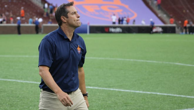 FC Cincinnati manager John Harkes walks to the sideline following the 1-0 win against Bethlehem Steel FC, Saturday, July 2, 2016, at Nippert Stadium in Cincinnati.