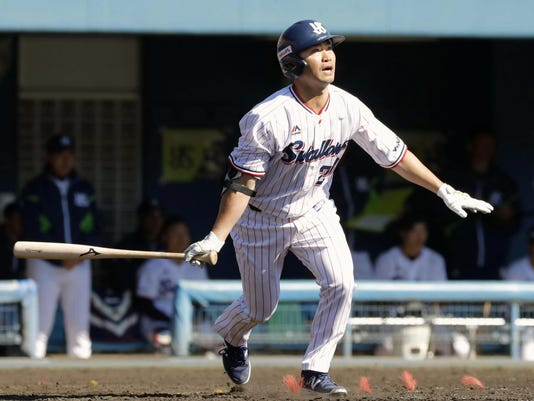 """In this March 6, 2018, photo, Yakult Swallows' Norichika Aoki watches the flight of his single to right field during a spring training baseball game against the Chunichi Dragons in Miyazaki, southwestern Japan. The 36-year-old outfielder Aoki returned to his former team. Over six years in the majors he had a batting average of .285 with 774 hits and 98 stolen bases in 758 games. """"I love this team for welcoming me back and will do everything I can to help them win,"""" Aoki said. (Naoyuki Shin/Kyodo News via AP)"""