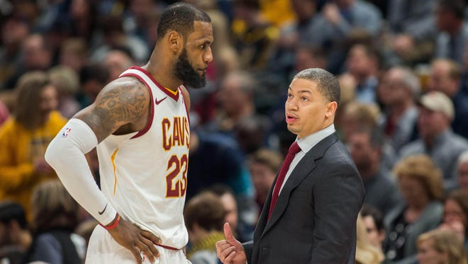 Cleveland Cavaliers forward LeBron James (23) and head coach Tyronn Lue talk during a time out in the second half against the Indiana Pacers at Bankers Life Fieldhouse.