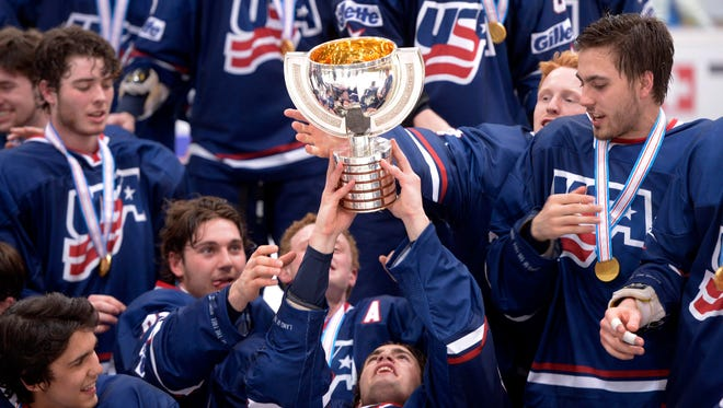 Team USA players lift their trophy as they celebrate winning a gold medal against Czech Republic at the world under-18 championships.