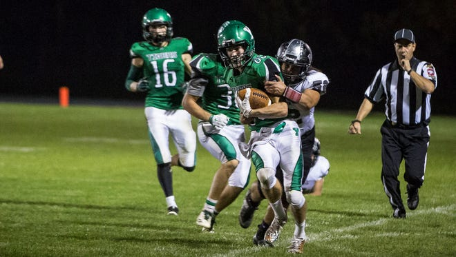 Yorktown's Brandt Applegate runs down the outside on Oct. 20 for the first round of the class 4A sectionals against Western. Western beat Yorktown 35-34.