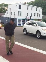 Beach Conger, a Burlington resident, walks Tuesday