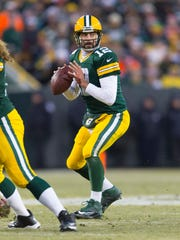 Aaron Rodgers looks to pass during the second quarter