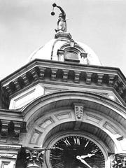A view of the Marion County Courthouse's goddess of justice is seen atop the cupola in 1950. The building was demolished in 1952. The goddess was moved to Willamette University.