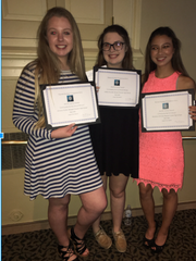 "Kristen Parker, from left, Caitlin Rosado and Madi McCully, members of the ""Exceptional Care for Children"" capstone project show off their certificate for the Ann M. Carney award"