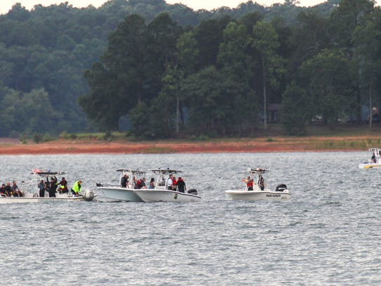 Emergency rescue workers and divers search for a man