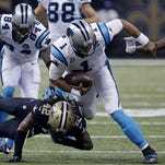 Carolina quarterback Cam Newton scrambles with the ball during last year's game against the Saints in New Orleans. The 11-0 Panthers return Sunday.