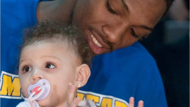 Kenneth Faried with daughter Kyla, 2011