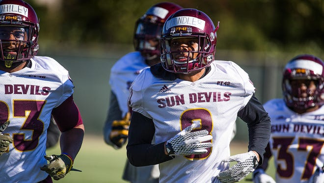 Defensive back Maurice Chandle runs during ASU football practice, Wednesday, March 23, 2016.