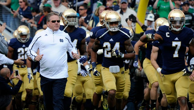 The NCAA is ordering Notre Dame to vacate wins from its 2012 and 2013 football seasons because a student athletic trainer committed academic misconduct by doing substantial course work for two players and giving six others impermissible academic extra benefits.