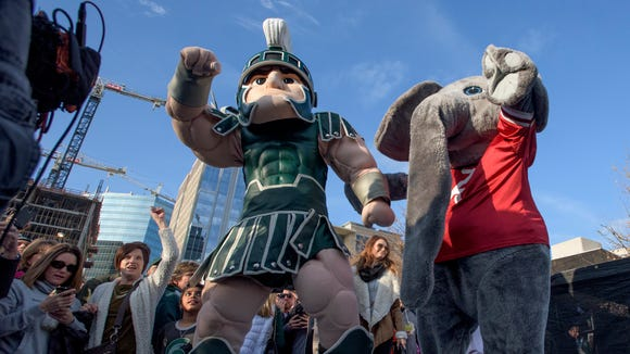 Michigan State mascot Sparty, left, and Alabama mascot Big Al fire up the fans during the Cotton Bowl Battle of the Marching Bands on Wednesday December 30, 2015 in Dallas, Tx.