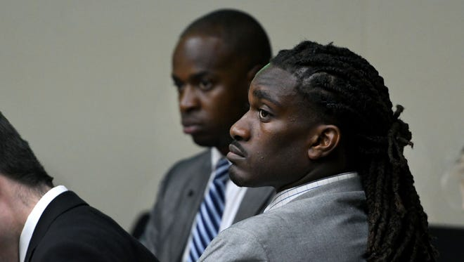 A.J. Johnson and Michael Williams, back, were back in court Monday, July 16, 2018 accused of raping a female athlete.