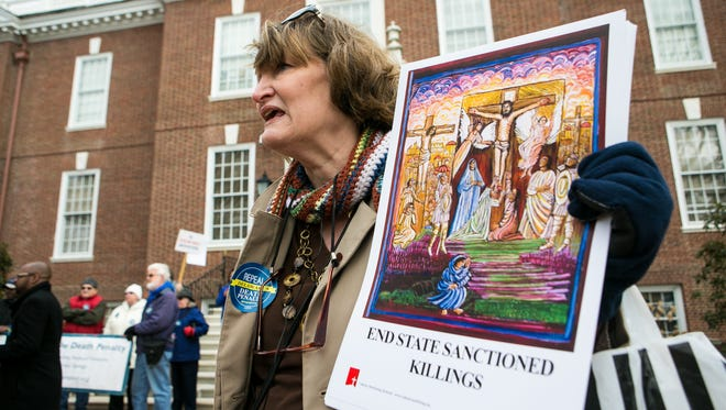 Kristin Froehlich, board president of Delaware Citizens Opposed to the Death Penalty, join a group of people gather outside Legislative Hall Monday morning for a protest rally, the first in a series of planned rallies protesting state lawmakers' failure to abolish Delaware's death penalty.