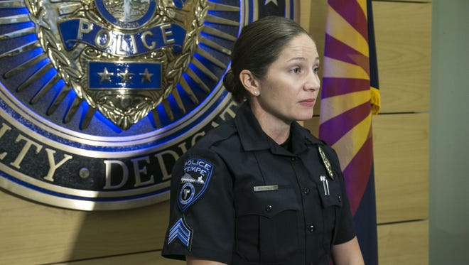 Tempe police Sgt. Josie Montenegro addresses the media on Thursday, August 18, 2016. Police say a man is dead and another wounded after a shooting involving rival gangs outside a Tempe bar.