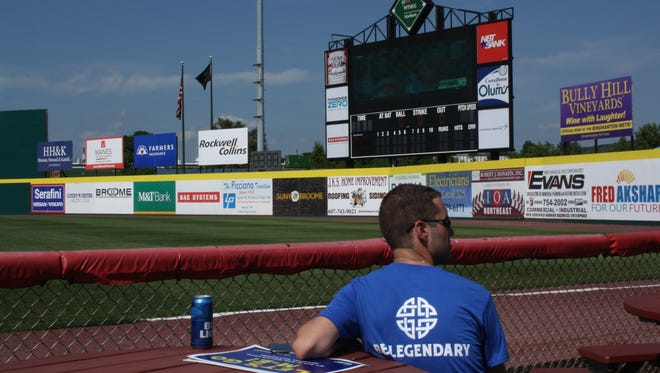 """Justin Seitz, 26, of Port Crane, watches the Little League World Series U.S. final at the """"Official Watch Party"""" at NYSEG Stadium."""
