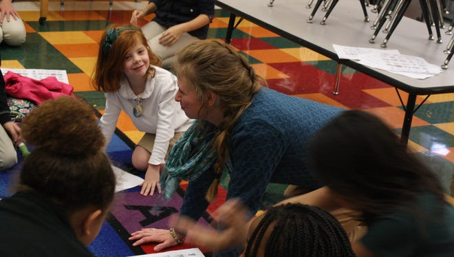 Ann Redmore, left, participates in Heather Shaffer's after-school ASL club at St. James Middle School.