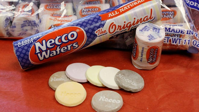 Necco Wafers are displayed in Boston. Four bidders are vying to buy New England Confectionery Company, of Revere, Mass., the bankrupt manufacturer of Necco Wafers, Sweethearts and other iconic candies. A bankruptcy auction is scheduled for Wednesday, May 23, 2018. Necco said in March is will close and lay off hundreds of workers if a buyer isn't found. The company traces its roots to 1847 and calls itself the nation's oldest continuously operating candy company.