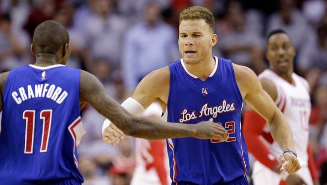 Los Angeles Clippers center Blake Griffin celebrates with teammate Jamal Crawford on May 4, 2015, in Houston.