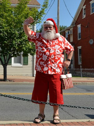 In this 2015 file photo, Santa Claus, aka Gary Bump of Lebanon, arrived for Destination Annville's Christmas in July event.